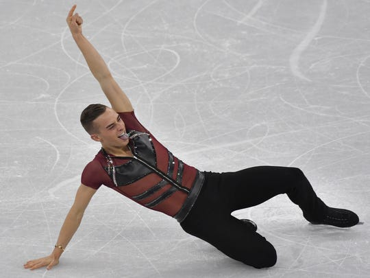 USA's Adam Rippon celebrates in the men's single skating short program of the figure skating event during the Pyeongchang 2018 Winter Olympic Games at the Gangneung Ice Arena in Gangneung on February 16, 2018. / AFP PHOTO / Ed JONESED JONES/AFP/Getty Images ORIG FILE ID: AFP_ZZ2P1