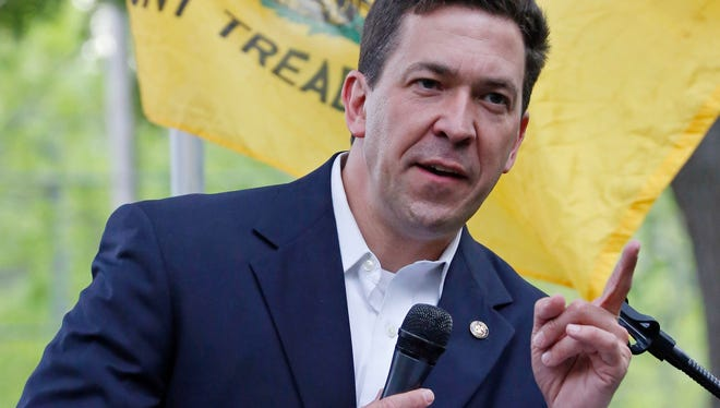 State Sen. Chris McDaniel, R-Ellisville, speaks before a crowd of partisan supporters gathered on the south lawns of the Mississippi State Capitol in Jackson, Miss., as part of the Tea Party Express that bused into the state Thursday, April 24, 2014, promoting their theme of fighting for liberty and constitutional conservatism. McDaniel, is running against incumbent U.S. Sen. Thad Cochran, R-Miss.