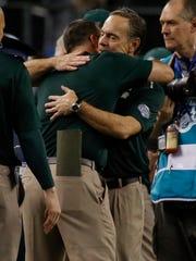 Michigan State Spartans head coach Mark Dantonio hugs