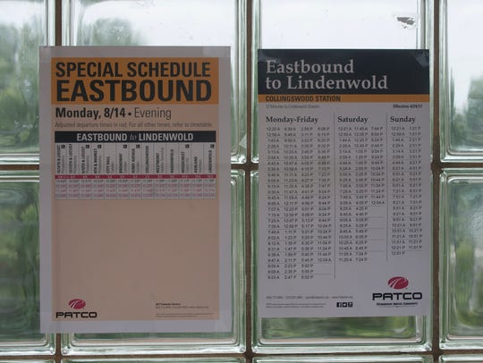 Paper timetables for PATCO trains are shown at the