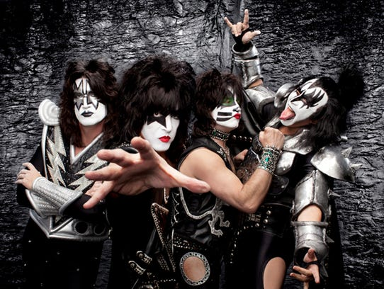 Gene Simmons, right, with his Kiss bandmates, doing