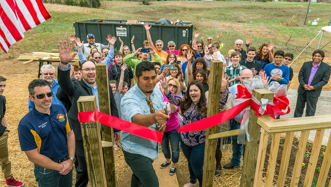 Cheatham Habitat for Humanity helped first time homeowner Moses Jonathan Del Carpio cut the ribbon to his new Habitat home Sunday.