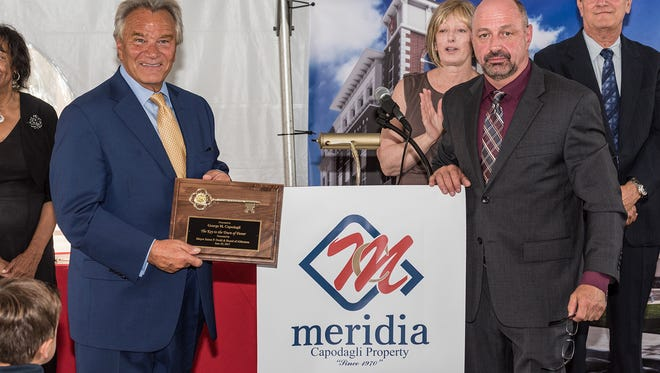 George Capodagli of CPC/Meridia, left of lecturn, leads a company that focuses on building upscale apartment communities near NJ Transit stations.