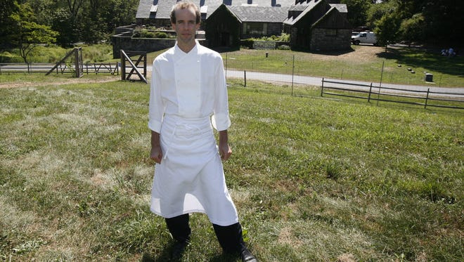 Dan Barber, the executive chef and co-owner of Blue Hill at Stone Barns, stands in the pasture at the Stone Barns Center for Food and Agriculture in Pocantico Hills.