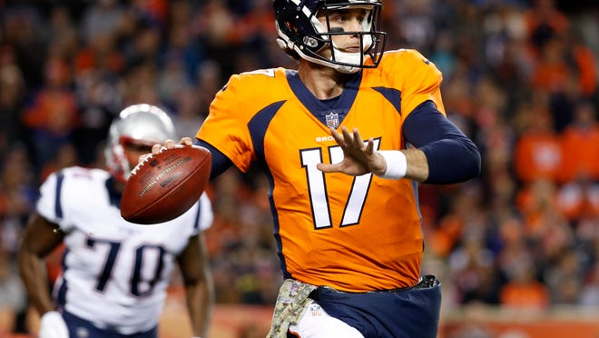 Denver Broncos quarterback Brock Osweiler (17) throws against the New England Patriots during the first half of an NFL football game, Sunday, Nov. 12, 2017, in Denver. (AP Photo/Jack Dempsey) ORG XMIT: COMY120