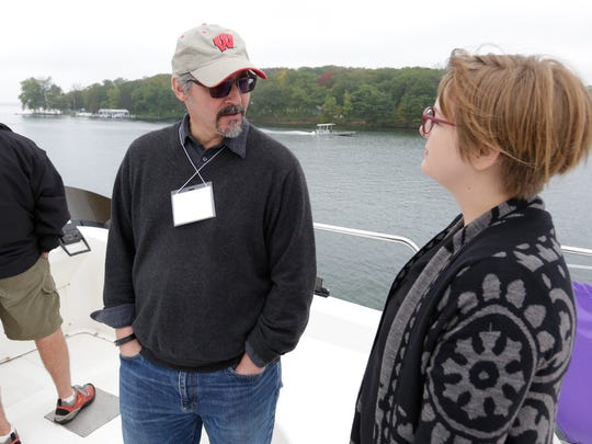 Dr. Paul Robbins of the Nelson Institute and UW-Madison talks with Stephanie Prellwitz of the Green Lake Association aboard the Escapade.  Green Lake Association and area lake leaders participated in a boat tour on the Heidel House Resorts and Spa's Escapade for an interactive and informational tour of Green Lake to share collaborative efforts among community organizations, UW-Madison, Ripon College and others to preserve Green Lake October 5, 2015.