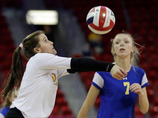 Mukwonago libero Katie Schoessow  receives serve in a Division 1 quarterfinal against Burlington on Thursday at the Resch Center in Ashwaubenon.