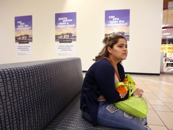 Claudia Jimenez waits for her family to finish shopping