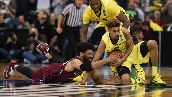 March 20, 2016; Spokane , WA, USA; Oregon Ducks guard Tyler Dorsey (5) and forward Jordan Bell (1) play for the ball against St. Joseph's Hawks forward DeAndre Bembry (43) during the second half in the second round of the 2016 NCAA Tournament at Spokane Veterans Memorial Arena. Mandatory Credit: Kyle Terada-USA TODAY Sports