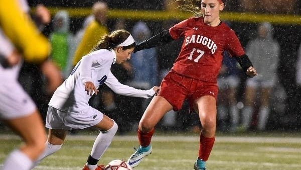 Madison Goyetche as a Saugus freshman is shown attempting to knock the ball free from a Swampscott player during the Division 3 North quarterfinals in Melrose in 2018. Goyetche is now a junior captain, one of four on the Sachems this year.