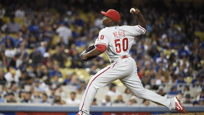 Jul 9, 2015; Los Angeles, CA, USA; Philadelphia Phillies relief pitcher Hector Neris (50) works against the Los Angeles Dodgers in the eighth inning at Dodger Stadium. Mandatory Credit: Richard Mackson-USA TODAY Sports