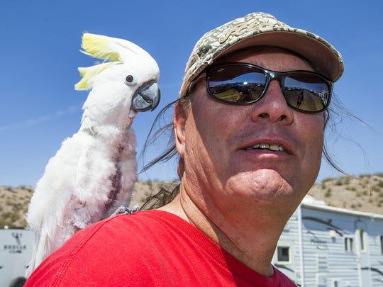Richard Arnold and his cockatoo, Sammy, cruise around