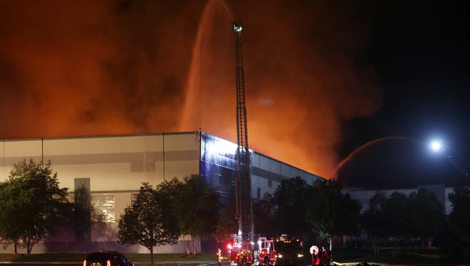 Firefighters from over a dozen departments battle a stubborn fire at the Gap Distribution Center in Fishkill Aug. 29, 2016. The large warehouse is located at the intersections of Interstate 84 and Route 9 in Fishkill.