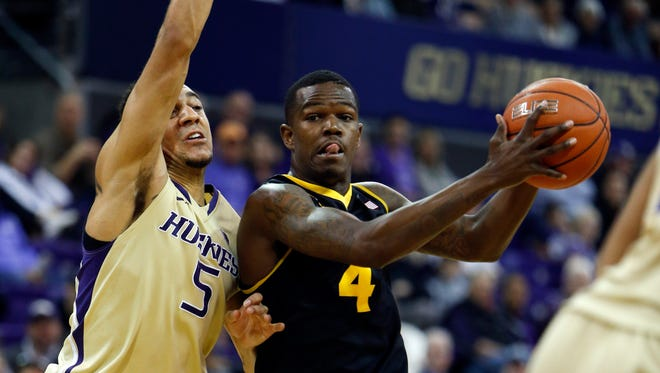 Feb 15, 2015: Arizona State Sun Devils guard Gerry Blakes (4) drives to the basket on Washington Huskies guard Nigel Williams-Goss (5) during the second half at Alaska Airlines Arena.