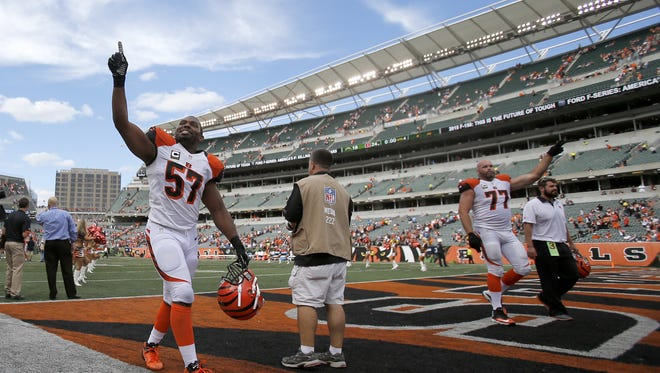 Cincinnati Bengals outside linebacker Vincent Rey (57), left, and Cincinnati Bengals tackle Andrew Whitworth (77), right, celebrate the 24-19 win over San Diego, Sunday, Sept. 20, 2015, at Paul Brown Stadium, in Cincinnati, Ohio.