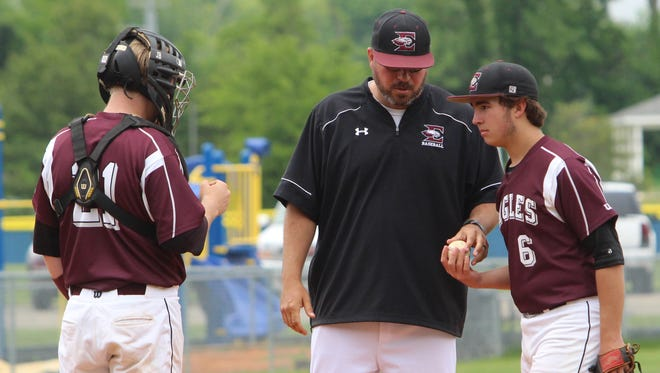 Eagleville coach Travis Holland hands the pitching duties to Austin Wells (6) in the fourth inning after the Cougars put four runs across in the inning during their Region 5-A baseball semifinal Tuesday in Clarksville.