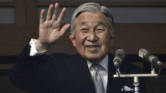 Japan's Emperor Akihito waves to well-wishers through a bullet-proof glass from a balcony during the New Year's public appearance at the Imperial Palace in central Tokyo, Japan, on Jan. 2, 2017.
