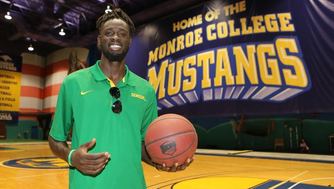 In this July 25, 2015, file photo, former Monroe College basketball star Maurice Ndour is pictured at the Monroe College Sports Facility in New Rochelle. Ndour has signed a two-year contract with the Knicks.