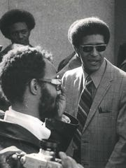 Ken Cockrel, Sr. pictured here (on right) in 1970, epitomized the post-riot era when African Americans forcefully demanded their piece of the pie and challenged the white establishment in city hall, schools, neighborhoods, courts, factories, jails and police precincts.