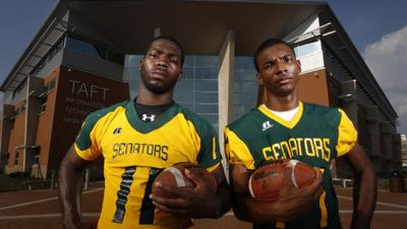 Adolphus Washington (left) and Dwayne Stanford in front of Taft High School in July 2011.