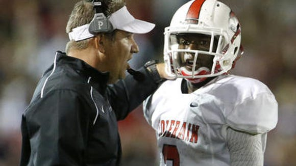 Colerain coach Tom Bolden (let) and senior quarterback Deshaunte Jones in a game Oct. 2.