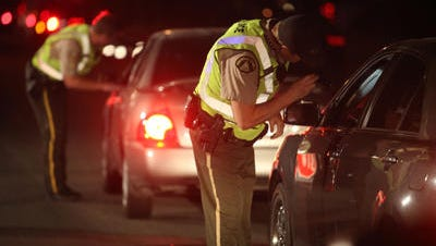 Police conduct a DUI checkpoint.