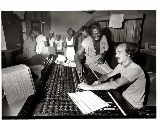 George Clinton works with engineer Jim Vitti at the mixer at Detroit's United Sound studio in 1977.