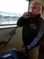 Capt. Bob Thibaudeau calls distances to members of