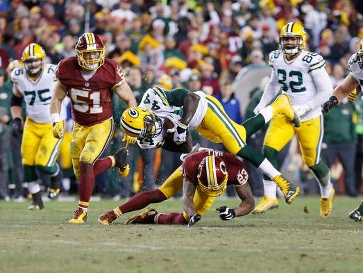 Green Bay Packers running back James Starks (44) leaps