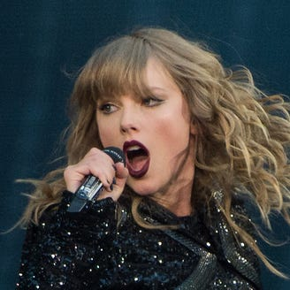 Taylor Swift is hilariously shocked when two fans get engaged at her meet-and-greet