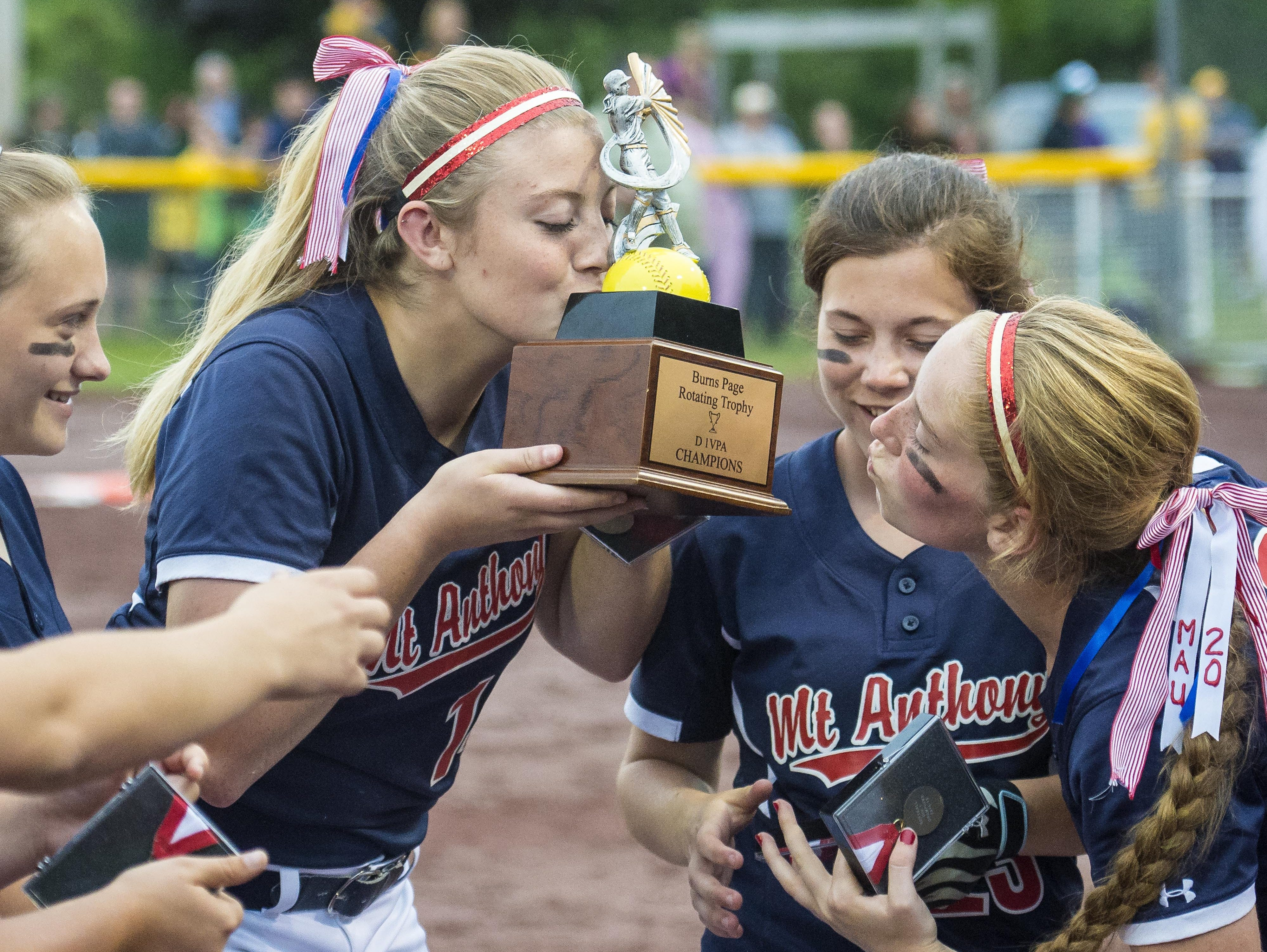 Mt. Anthony's Marleigh Greene, left, and Keira Goodell kiss the trophy after defeating BFA in the Division I state high school softball championship in Poultney on Monday, June 15, 2015.
