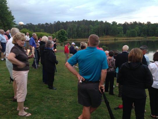Candlelight vigil for Lake Oconee couple