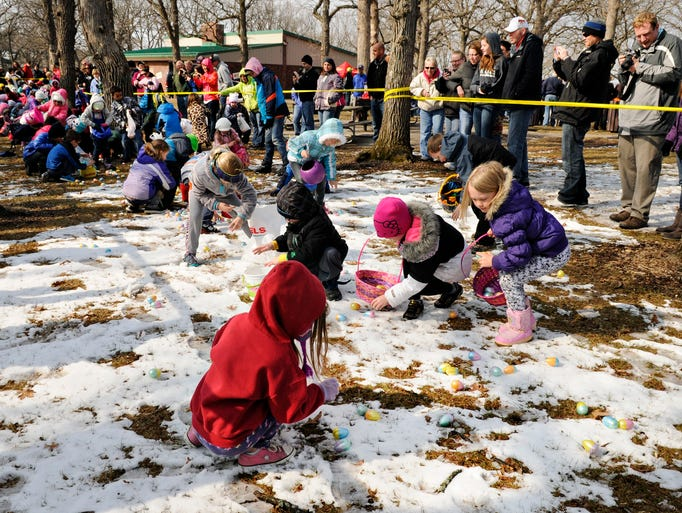 Children rush out to find plastic eggs loaded with candy and prizes at the start of the annual Easter Egg Hunt in Riverside Park Saturday.