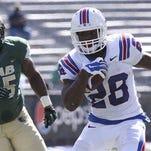 Louisiana Tech running back Kenneth Dixon (28) runs past UAB defensive tackle Jontavious Morris (55) in last season's game.