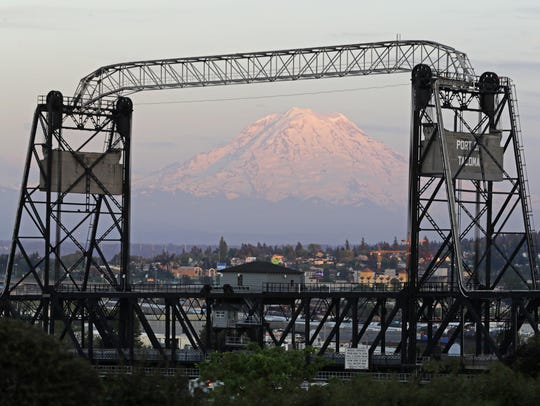 Mount Rainier is seen at dusk and framed by the Murray
