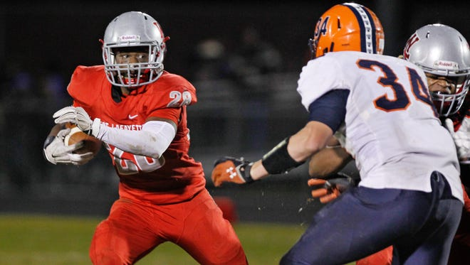 West Lafayette's Travis Rolle with a carry against North Montgomery in the sectional championship Friday, November 6, 2015, at Gordon Straley Field in West Lafayette. West Lafayette defeated North Montgomery 35-28.