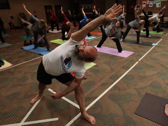 Yoga instructor Steven Russell works with a group at Monmouth County Library in Manalapan. He runs a male-only yoga class three times a week from his home.