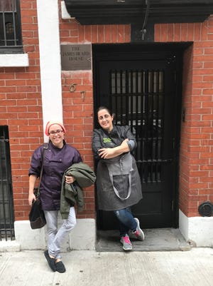 Chef Toni Elkhouri (right) of Cedar's Cafe, stands in the doorway of the James Beard House in New York City with her sous chef, Brittney Comer.