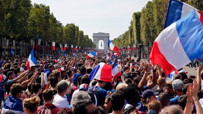 French flags fly.
