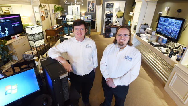Alex Davis, left, is director of operations, and Roger Karnitz is store manager at Madison Computer Center.