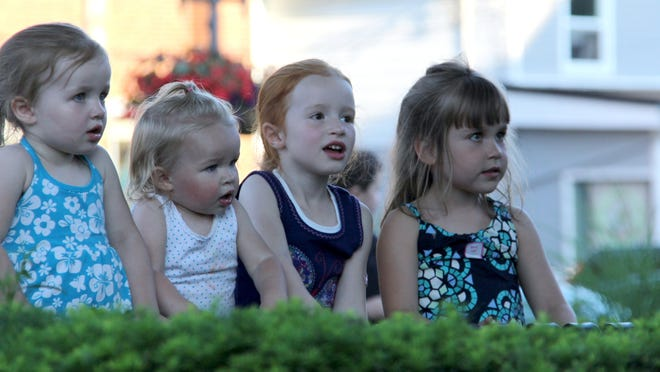 The Landis sisters, from left, Leah, 3, Laura, 18 months, and Lily, 5, and their friend Samantha Webster, 5, all of Brockport, enjoy a recent Cool Kids in the Park event.