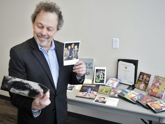 Curtis Armstrong, an actor, producer and writer, holds some of the 30-years of memorabilia from his career in film and television at Oakland University in Rochester, Mich. Armstrong, an alumnus of the university, has donated the material to Oakland University's archives