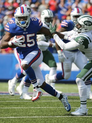 Bills running back LeSean McCoy stiff arms Jets safety Marcus Maye for extra yards.