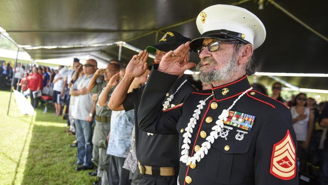 In this file photo, former U.S. Marine Corps Gunnery Sgt. Raul Hinojosa, right, and other veterans render salutes as the Joint Color Guard parade the American, Guam and service branch flags into the Veterans Day ceremony at Adelup on Nov. 11, 2016. Hinojosa, 88, served during World War II, the Korean War and the Vietnam War and was recognized as the oldest veteran on Guam during the ceremony, according to Guam Air National Guard Senior Master Sgt. Luis Camacho.Veterans are invited to attend a town hall meeting Wednesday.
