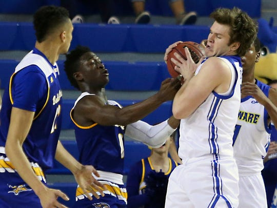 Delaware's Ryan Daly (right) grabs a rebound in front of CSU Bakersfield's Jarkel Joiner in the first half at the Bob Carpenter Center Wednesday.