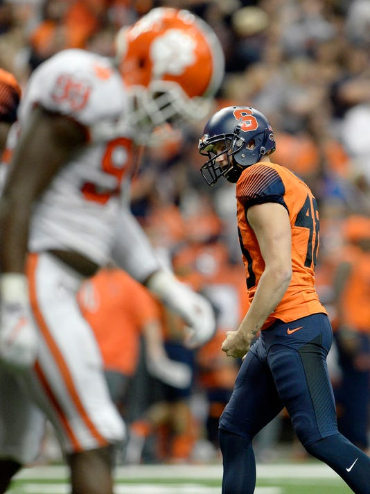 Syracuse kicker Cole Murphy (48) reacts to his go-ahead field goal during the second half of an NCAA college football game against Clemson, Friday, Oct. 13, 2017, in Syracuse, N.Y. Syracuse upset No. 2 Clemson 27-24. (AP Photo/Adrian Kraus)