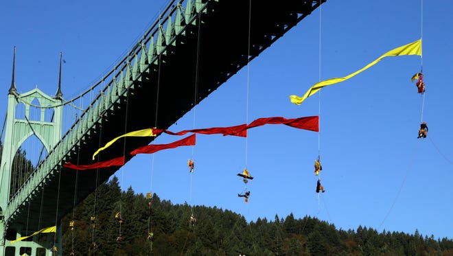 Activists hang from the St. Johns bridge in an effort to block the  Royal Dutch Shell PLC icebreaker Fennica from leaving for Alaska in Portland, Ore., Thursday, July 30, 2015.