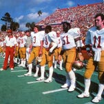 Florida State assistant coach Jim Gladden, left, Garry Futch (79), Rohn Stark (3), James Harris, James Gilbert (51) and Rick Stockstill (11) line up at Florida Field.