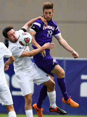 Missouri State's Phil Woods and Evansville's Ryan Koenig try to control the ball as the Evansville mens soccer Aces hosts Missouri State at Arad McCutchan Stadium Saturday, October 1, 2016.