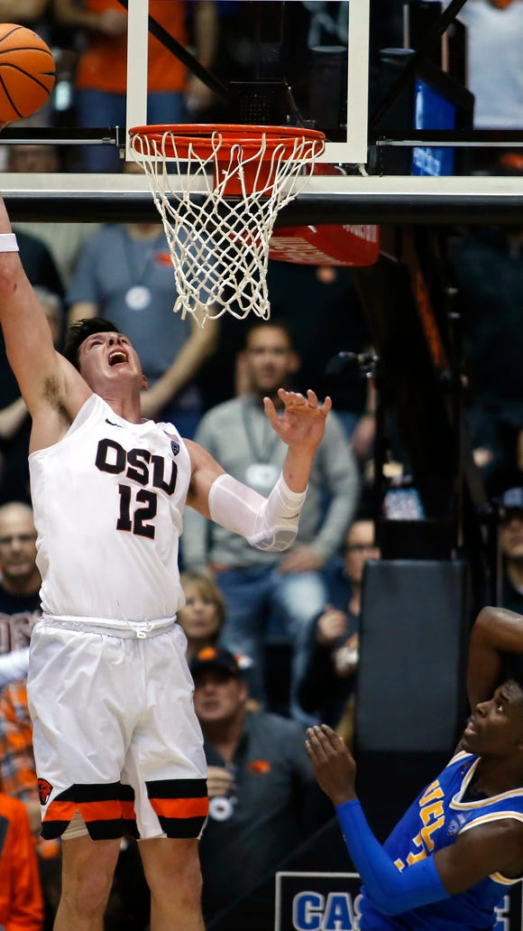 Oregon State's Drew Eubanks scores during the second half of the team's NCAA college basketball game against UCLA in Corvallis, Ore., Thursday, Jan. 18, 2018. Oregon State won 69-63. (AP Photo/Timothy J. Gonzalez)